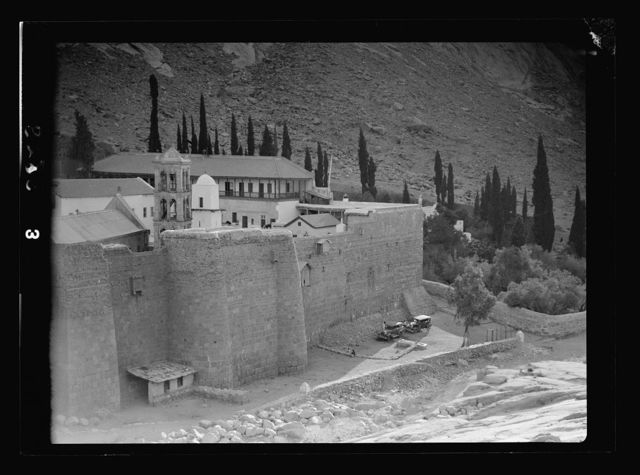To Sinai by car. St. Katherine's [i.e., St. Catherine's] Monastery in Sinai showing outer walls, belfry, and minaret