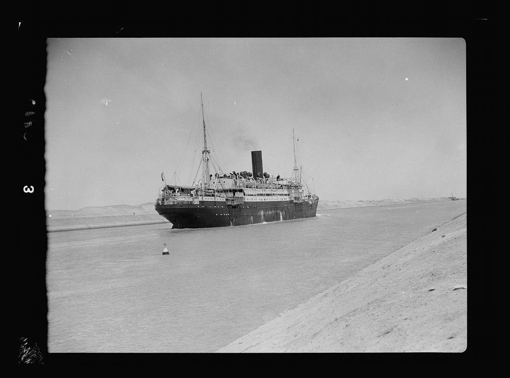 To Sinai by car. The Suez Canal. Steamship passing through