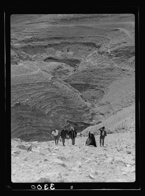 Transjordan. East of the Dead Sea. Machaerus. Climbing el-Meshneka showing deep gorge surrounding it