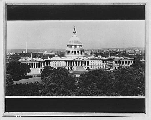 U.S. Capitol exteriors. East front of U.S. Capitol with city in background I