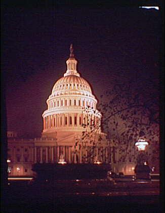 U.S. Capitol exteriors. Night view of U.S. Capitol, vertical