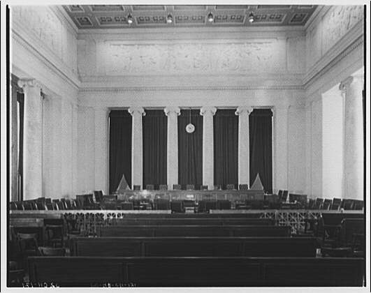 U.S. Supreme Court interiors. Courtroom in U.S. Supreme Court from rear with wide angle lens