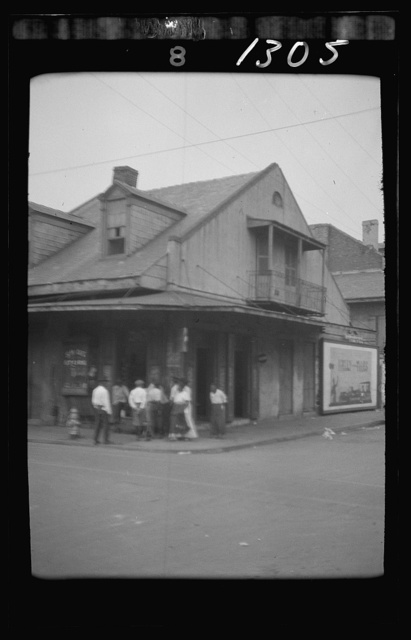 View from across street of a group of men on a street corner, New Orleans