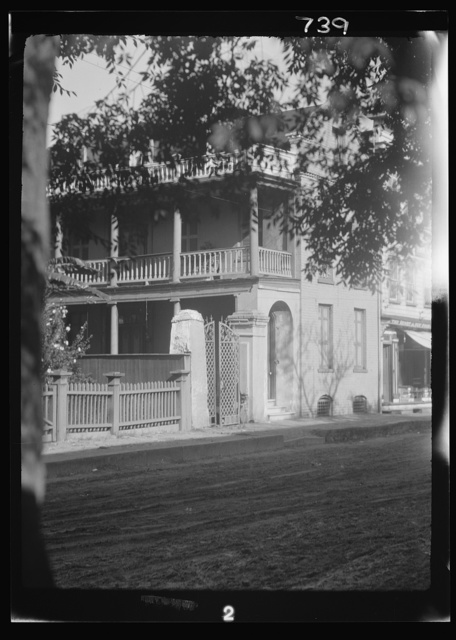 View from across street of a multi-story house, New Orleans or Charleston, South Carolina