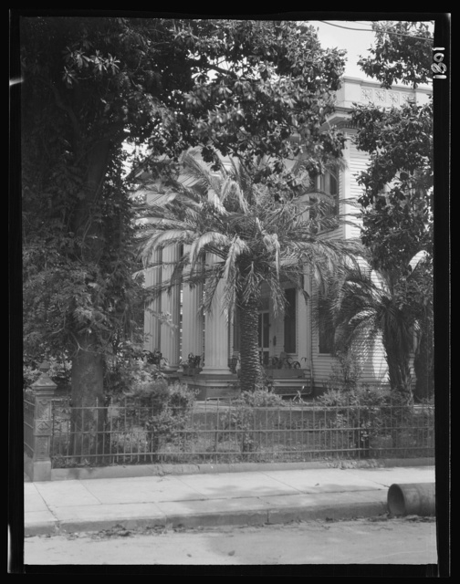 View from across street of a two-story house with columned portico, New Orleans or Charleston, South Carolina