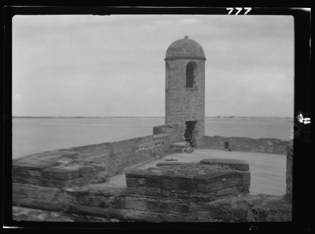 Walls and round tower by the water, Castillo de San Marcos, St. Augustine, Florida