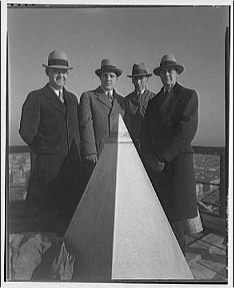 Washington Monument. Group of men standing by cap stone of Washington Monument II