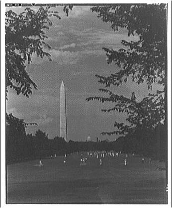 Washington Monument. View of Washington Monument from parkway with people playing II