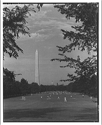 Washington Monument. View of Washington Monument from parkway with people playing III