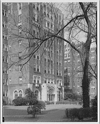 Westchester Apartments. Exterior of Westchester Apartments with tree in foreground