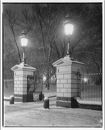 White House exteriors. Gates to grounds of White House at night in winter