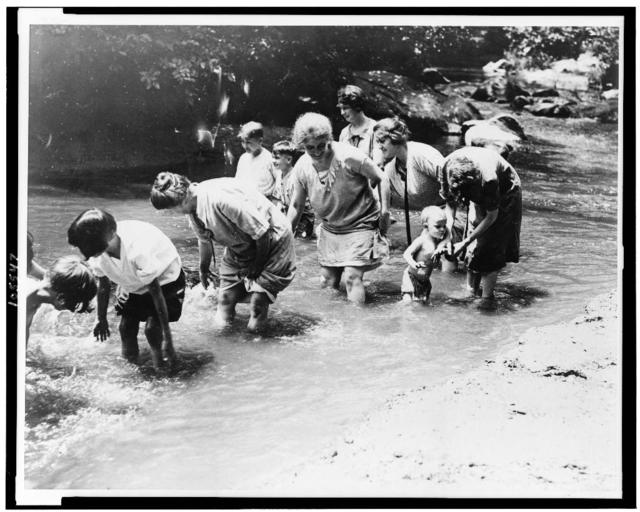Women and children find some relief by wading in the creek on one of the hottest days in the history of the Capital. Snapped in Rock Creek Park today