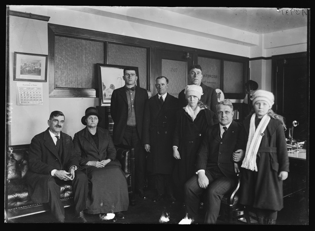 A committee of unemployed wives fron West Virginia fields called on Pres. Harding & explained the conditions that now exist at their homes. Pres. Harding is trying to do all he can to better conditions. [...] called on Secy. of Labor Davis. Left to right: Lawrence Dwyer, Mrs. Alice Underwood, Alex Martin, Ed Williams, Hattie Underwood, Secy. Davis, Dorothy Underwood & Carl Brown (in back)