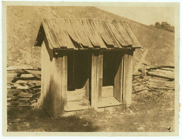 A poor toilet, of the old style at Buzzard School. These will be replaced later by concrete toilets.  Location: Pocahontas County, West Virginia / Photo by L.W. Hine.
