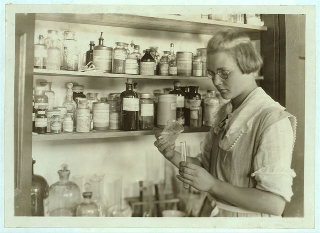 A Third year high school girl in the chemical laboratory, - Greenbank Consolidated School, Oct. 7, 1921.  Location: Pocahontas County, West Virginia / Photo by Lewis W. Hine.