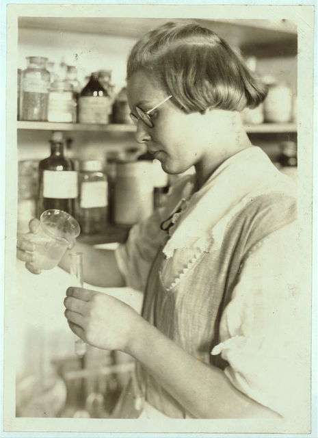 A Third year high school girl in the chemical laboratory - Greenbank Consolidated School.  Location: Pocahontas County, West Virginia / Photo by Lewis W. Hine.