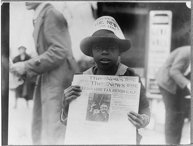 """[African American boy selling The Washington Daily News - sign on his hat reads, """"Have you read The News? One cent"""" -  headline reads """"Millionaire tax rends G.O.P.""""]"""