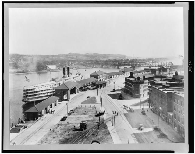 [Bird's-eye view of wharf area of Albany, New York, showing night boat landing, and bridge in background]