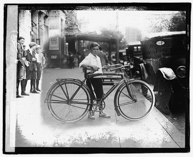 [Boy on bicycle]