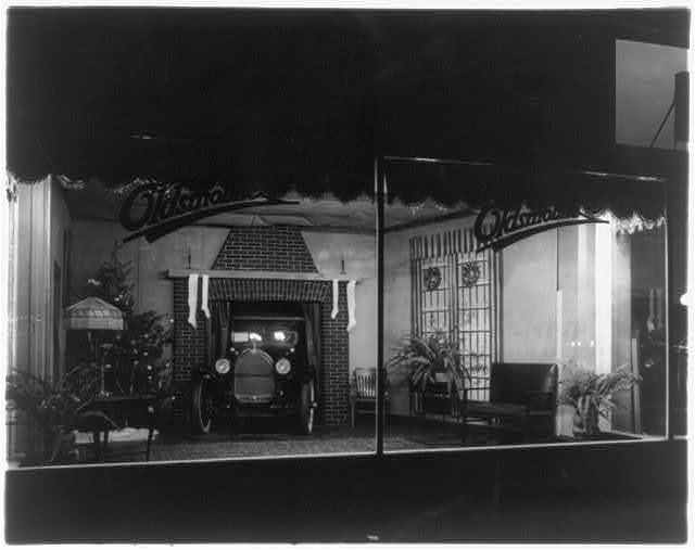 Christmas window display at an unidentified Oldsmobile dealer's, probably in Washington, D.C.