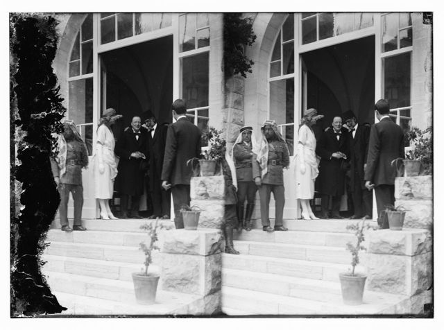 [Emir Abdullah (third from left) with Mrs. Churchill and Winston Churchill in doorway receiving Mousa Kasim Pasha el Husseini at reception at Government House, Jerusalem]