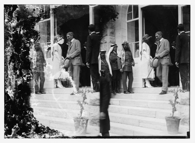[Emir Abdullah (third from left)and Sir Anton Bertram, Chief Justice of Ceylon coming down steps, during reception for Winston Churchill, Government House, Jerusalem]