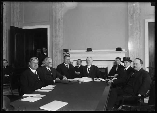 [Group at table; Hiram Johnson, left]
