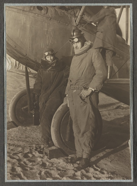 [Helen Johns Kirtland and Lucian Swift Kirtland standing next to an airplane in Berlin, Germany]