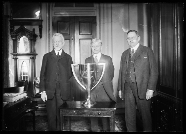 [Henry Cabot Lodge, Thomas R. Marshall, Oscar Underwood and trophy cup]
