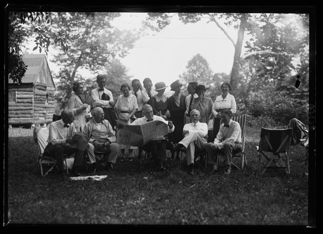 [Henry Ford, Thomas Edison, Warren Harding, Harvy Firestone and group near cabin, Firestone camp]