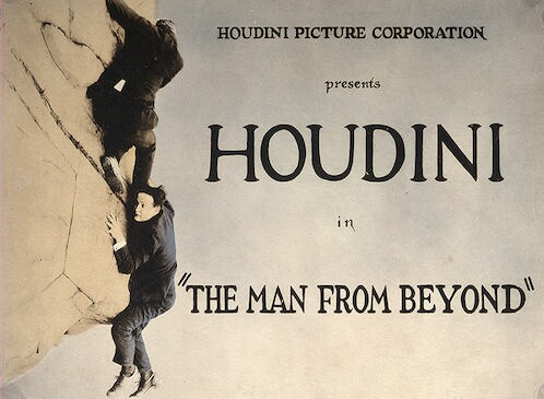 "[Houdini and man on cliff in scene from ""The man from beyond""]"