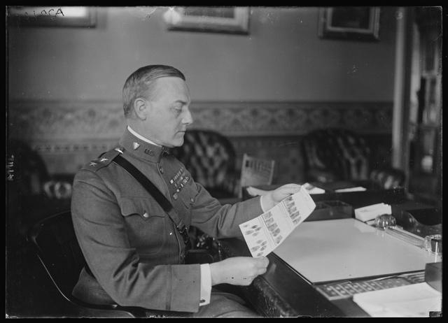 Maj. Gen. Robert C. Davis, Adjutant Gen. of the Army, looking at his finger prints the first to be taken under a recent War Dept. order