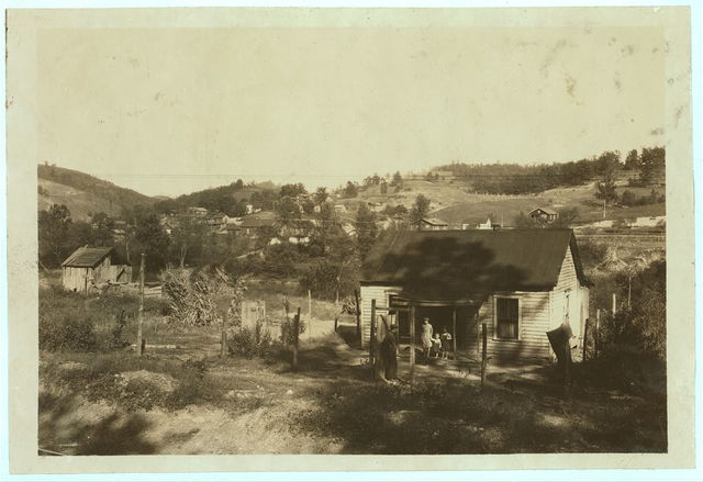 Miners cabins on the Elk River at Bream, W. Va. near Charleston. Others on slope beyond. A typical mining community here. Children go to Big Chimney school. Oct. 10, 1921.  Location: Bream, West Virginia / Photo by Lewis W. Hine.