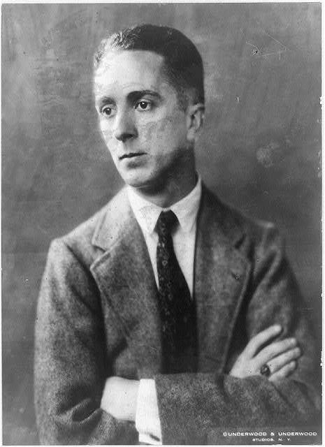 [Norman Rockwell, half-length portrait, facing left, arms folded]