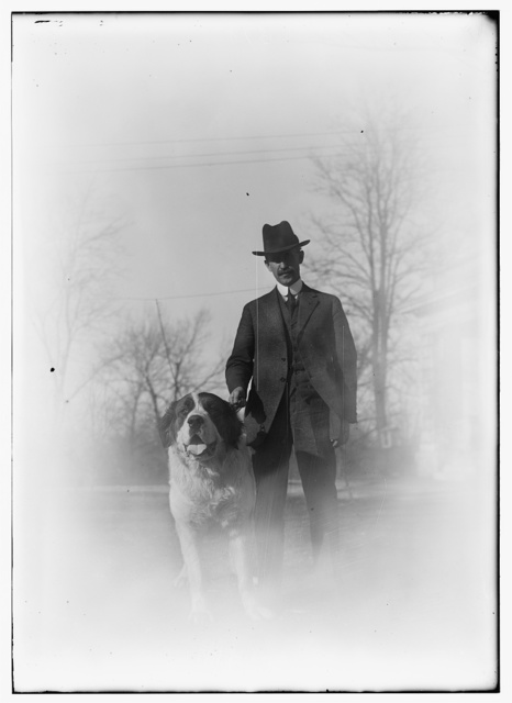 [Orville with Scipio, a St. Bernard dog he acquired in March, 1917]