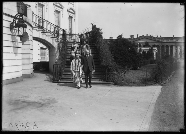 [President and Mrs. Harding with Native Americans outside White House, Washington, D.C.]