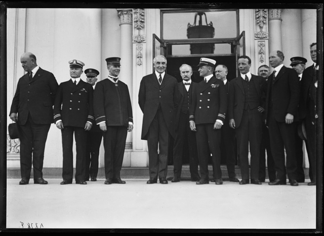 [President Harding and group; includes Edwin Denby, left; Albert Fall, to right of Harding; and Theodore Roosevelt, Jr., 5th from right. White House, Washington, D.C.]