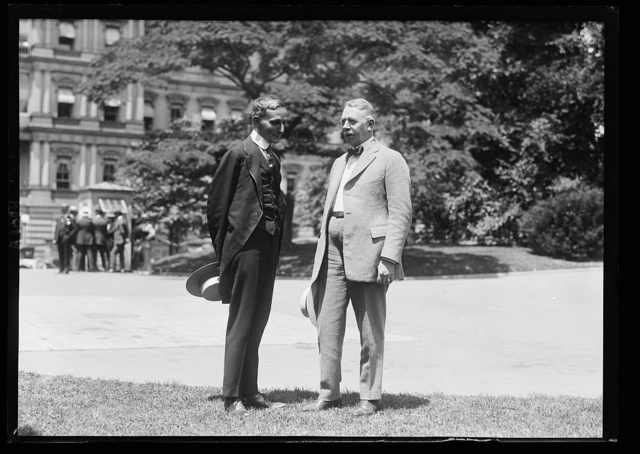 Resident Commissioner of Puerto Rico [at White House; State, War and Navy Building in background, Washington, D.C.]