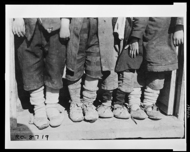 Samples of their footwear - showing the need for American shoes in the Greek camp at Salonica established for Greeks brought from the Caucasus for the purpose of colonizing their rewon province of Thrace American relief agencies are doing their best to provide food, clothing and medical aid for the stricken voyagers.