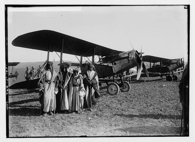 Sir Herbert Samuel's second visit to Transjordan, etc. Bedouin boys under wing of airplane.