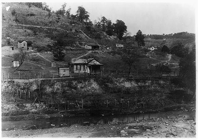 Slip Hill School - tiny one-room school in the country near Charleston; note the shacks on the hillside.  Location: Charleston [vicinity], West Virginia / Photo by L.W. Hine.
