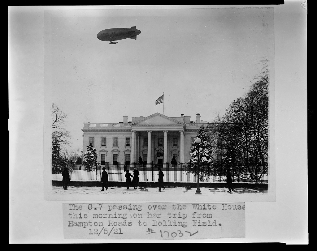 The C 7 passing over the White House this morning on her trip from Hampton Roads to Bolling Field