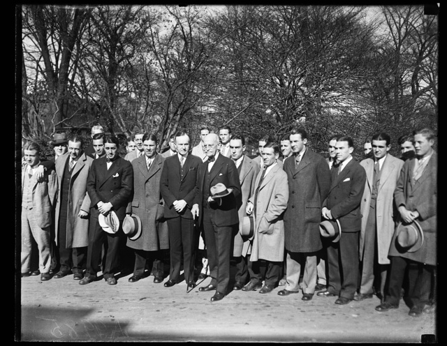 The Centre College football team, of Kentucky, in Washington to play Georgetown University, called on President Coolidge, today, Nov. 14th. In the center of the group can be seen the President and Senator Ernst, of Kentucky