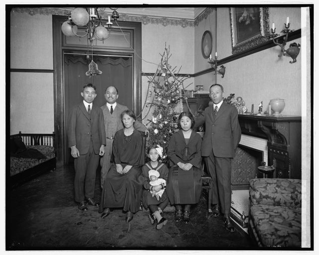 [Unidentified family with Christmas tree]