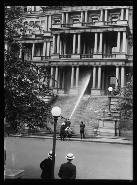 [Water hose aimed at State, War, and Navy Building, Washington, D.C.]