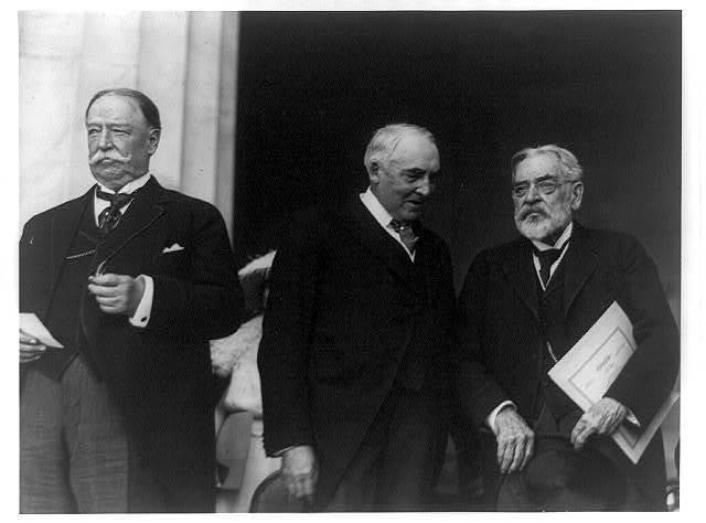 [William Howard Taft, Warren G. Harding, and Robert Todd Lincoln, standing, left to right]