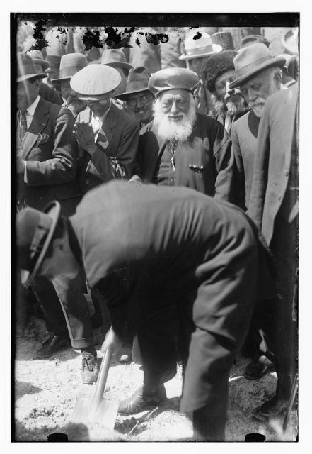 [Winston Churchill planting his tree at the site of Hebrew University, Mount Scopus, Jerusalem; Jewish rabbi in center, 1921]