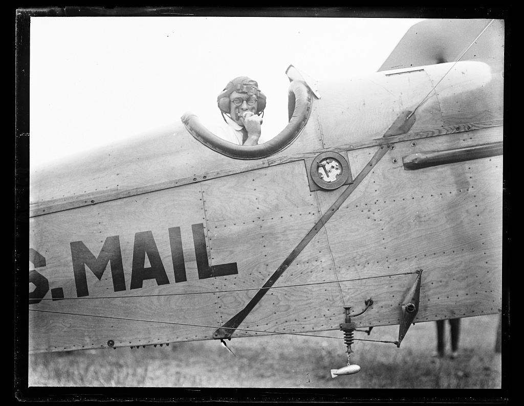 Close-up of a Post Office Dept. mail plane equipped with the new experimental radio apparatus with which the Dept. hopes soon to make possible night flying. The little lead fish at the bottom of the picture is let out while flying and carries with it a long copper wire which serves as the antennae. A sound-proof covering over the pilot's set and transmitter is necessary and the electricity is manufactured by a generator run by a free fan. Experiments conducted at Bolling Field, Wash. Aug. 2, 1922