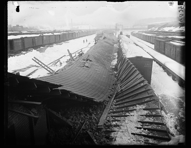 [Collapsed roof at train yard with snow]