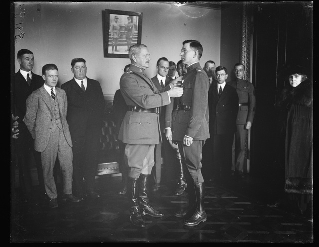 George E. Adamson, 1st. Lt. Quartermaster Corps, receiving Distinguished Service Cross from Gen. Pershing for his work as Confidential Secy. to Commander-in-Chief of the Amer. Expeditionary Forces and later to the Gen. of the Armies